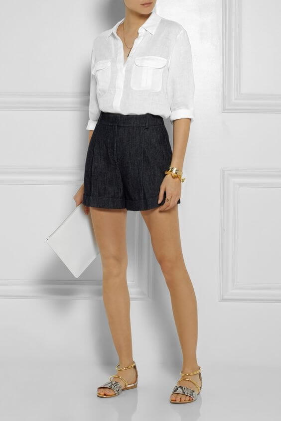 A classic white linen blouse beautifully complements these tailored shorts. Image: Net-a-Porter