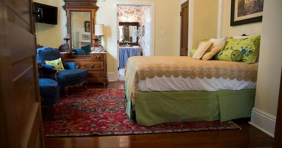 Each of the rooms at The Guest House at Gulfport feature beautiful antique furniture and en suite bath.