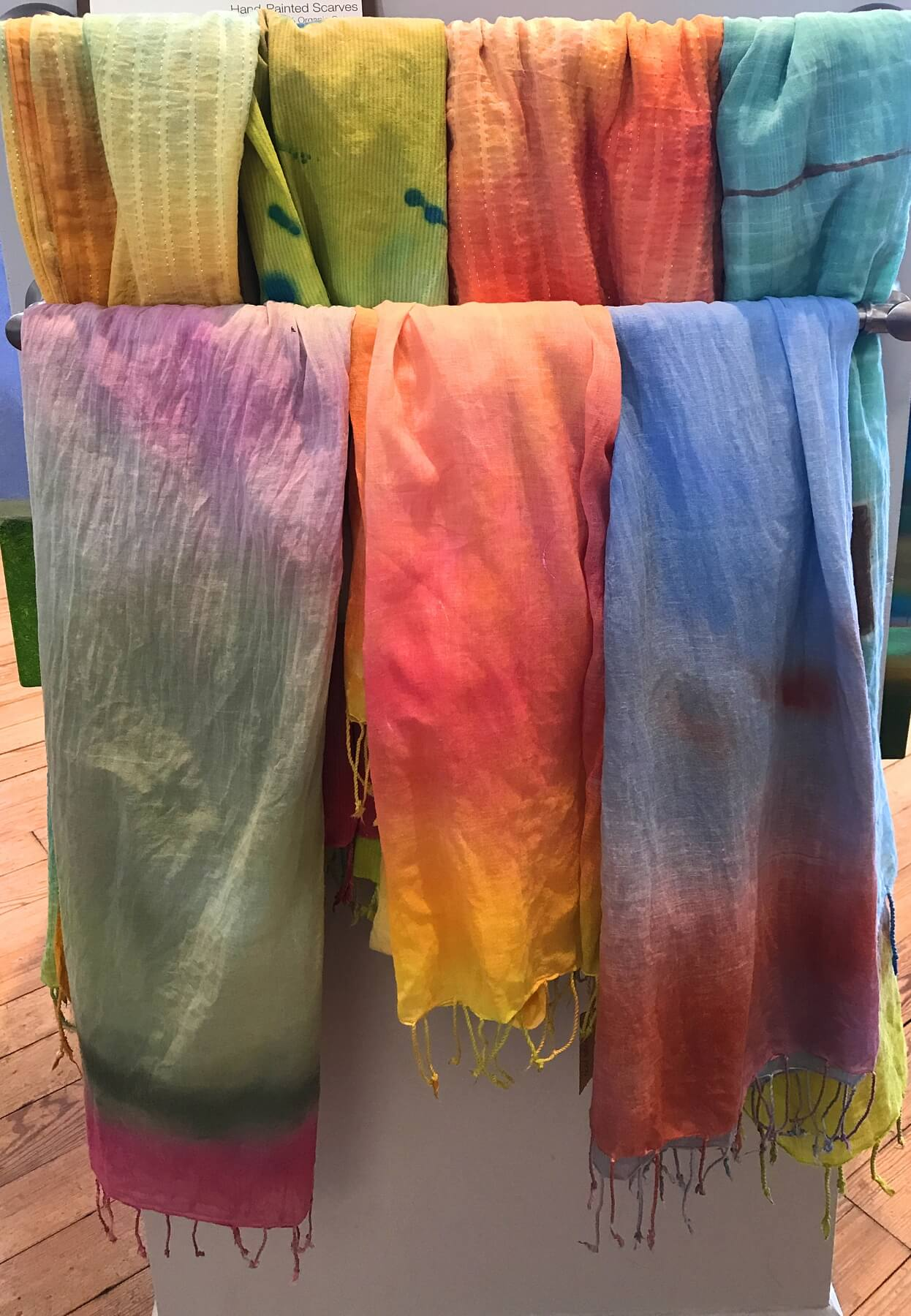 Hand-painted scarves, $65/short scarf, $85/long scarf, at T Clifton Art