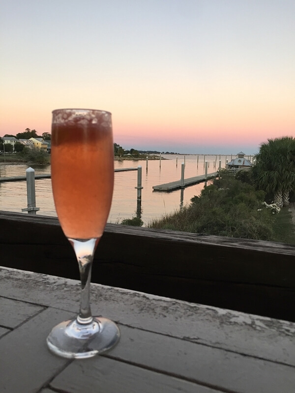 Ask for the Glass of Sunshine at The Deck Bar, next door to The Fish House. This specialty drink is a lovely mash-up of vodka, Limoncello, fresh strawberries, fresh-squeezed citrus, and champagne.