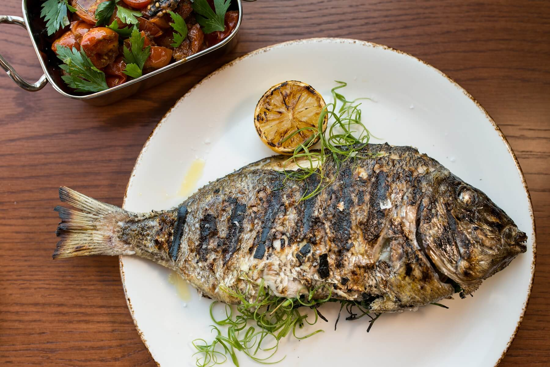 Donetto's whole-roasted fish with lemon and herbs is what dreams are made of. Image: Mia Yakel
