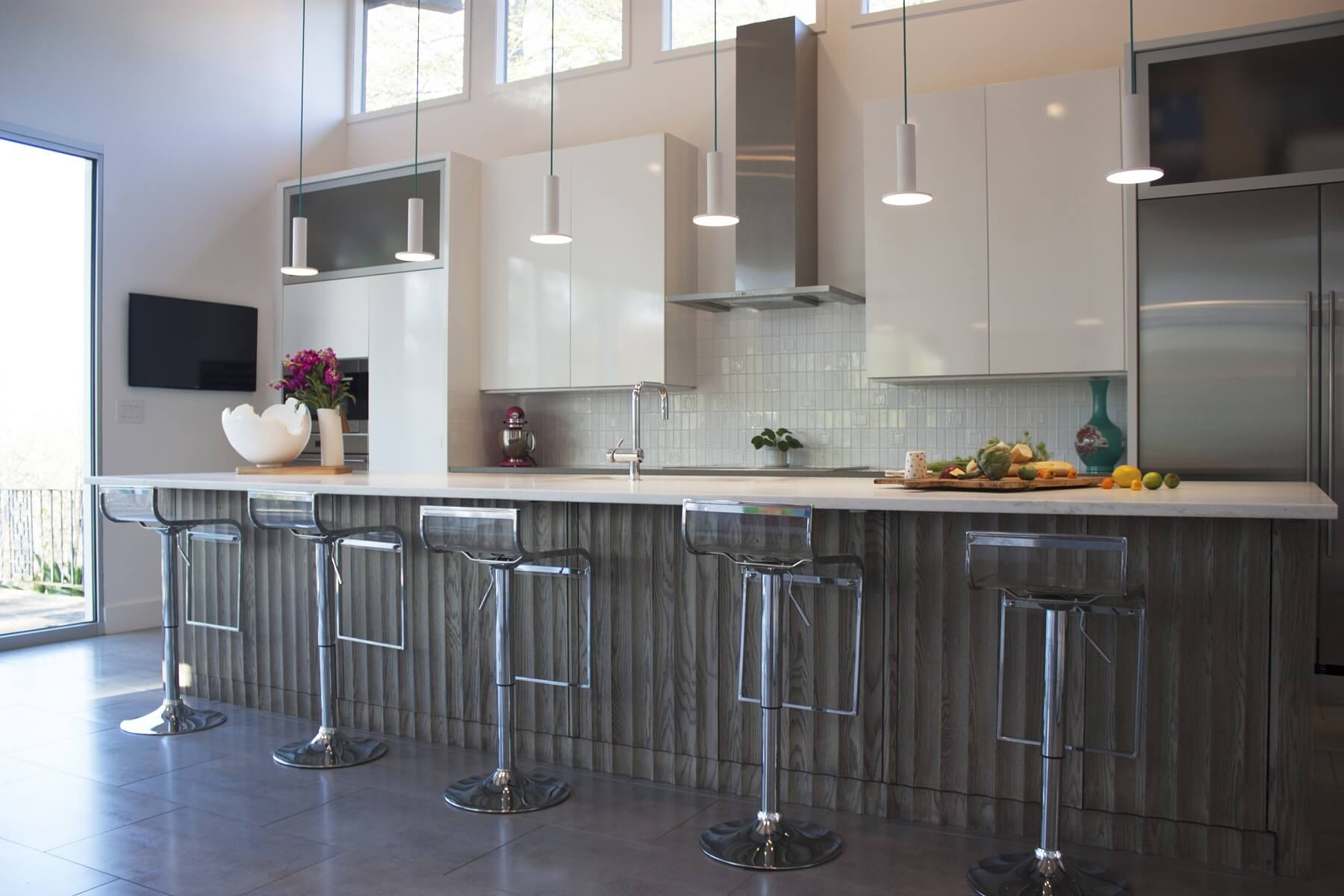 This cavernous kitchen is thoroughly modern with its gleaming surfaces and clean lines. Image: Anna Mitchell