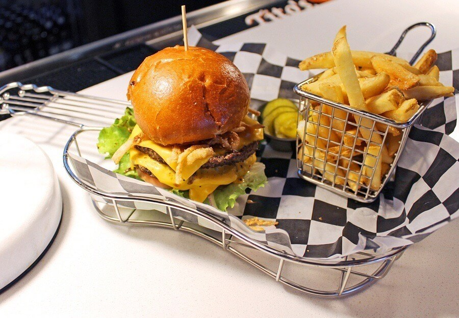 The Delta burger, whose key ingredient is ground brisket, comes served in a guitar-shaped metal basket at EP's Bar & Grill.