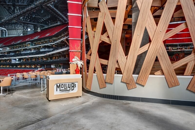 Molly B's is the stadium's custom restaurant concept, looking out right onto the field. The dining spot offers an exclusive club dining experience pre-game during Atlanta United and Falcons games, opening to all fans after the first quarter (Falcons) and after match start (Atlanta United).
