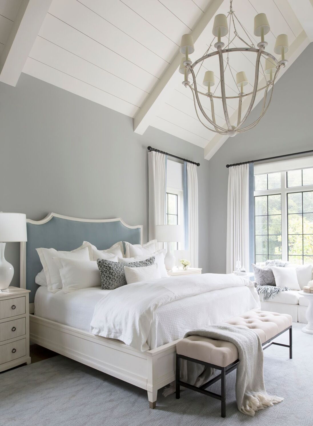 A velvet blue-gray headboard grounds the master bedroom, and sets the tone for its soft, dreamy vibe. Velvet trimwas added to the off-white linen draperies and pillows.