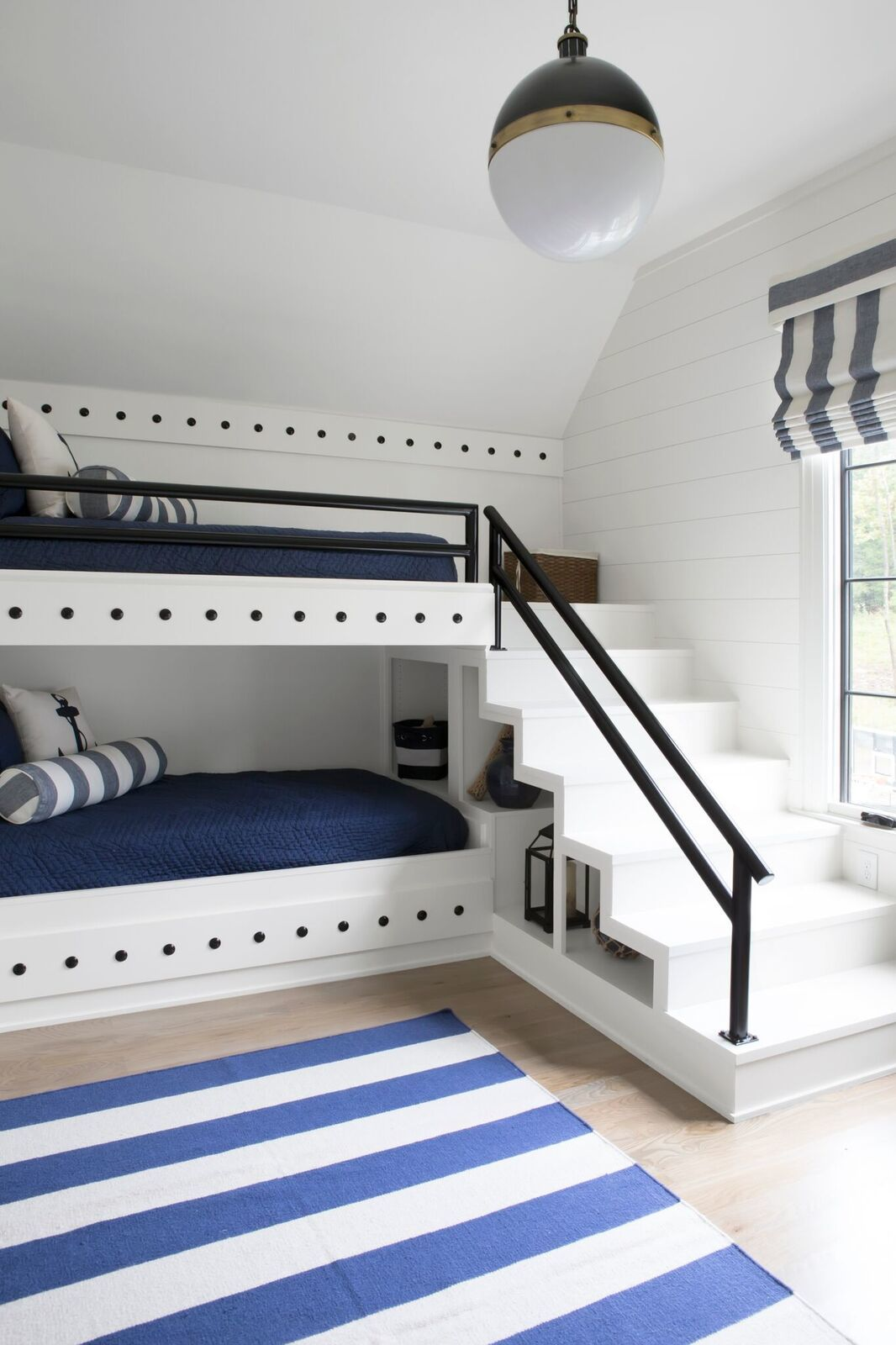 The bunk room, with its navy and white color scheme, is an ode to the homeowners' favorite place: the beach.