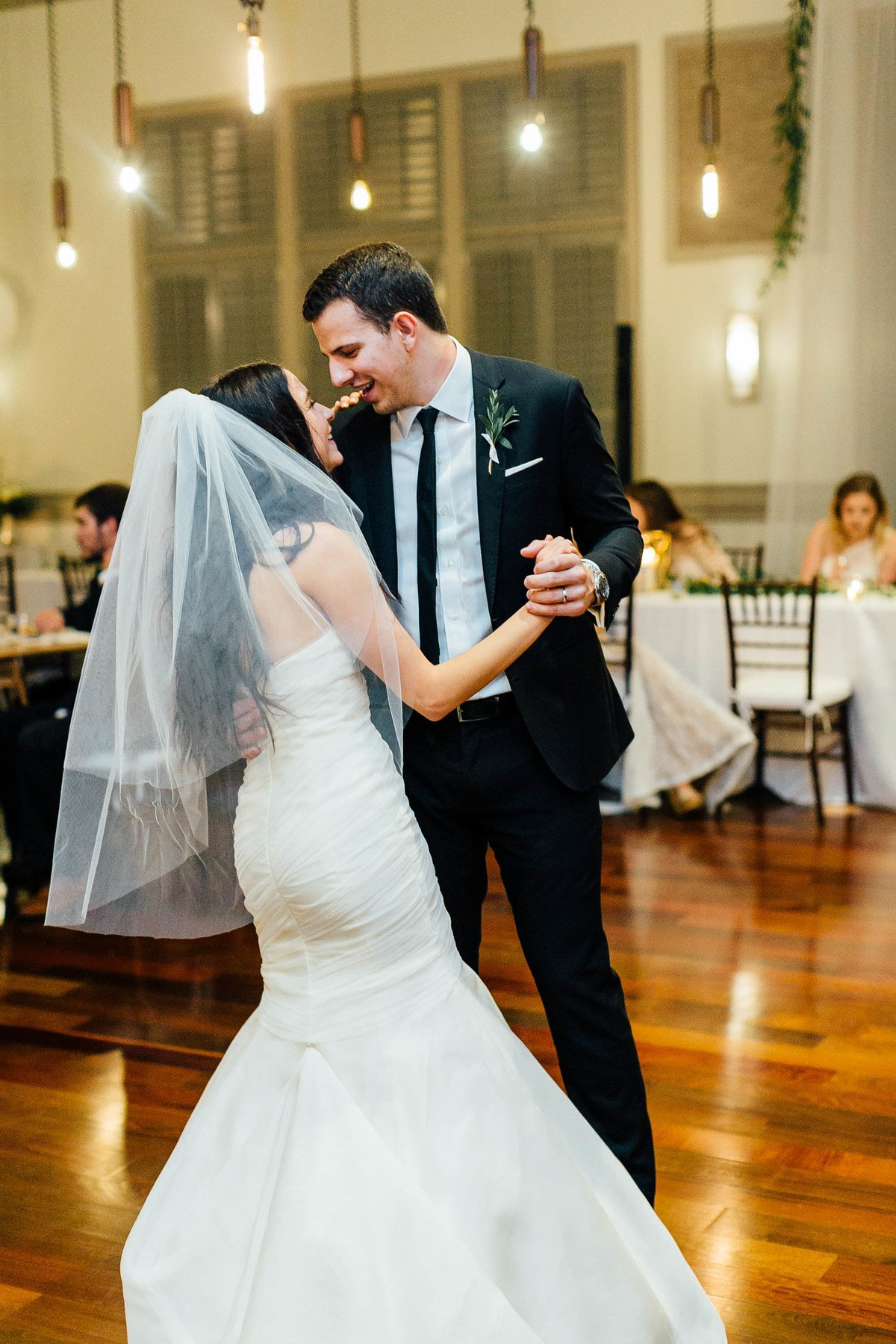 """The bride and groom's first dance was to a song special to both of them — """"ILYSB"""" by the band LANY."""
