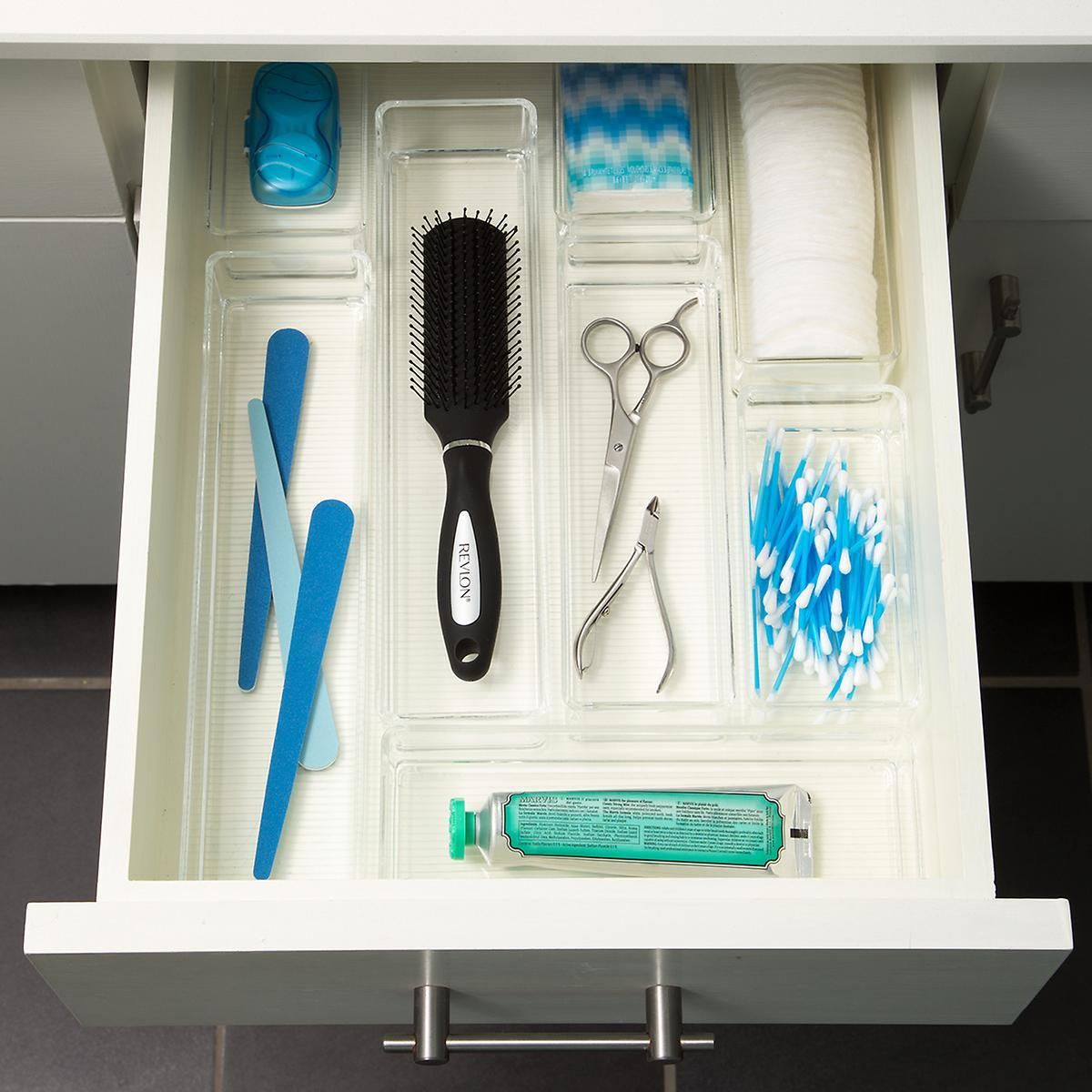 "Lastly, seperate and store all those items in your bathroom drawer with this acrylic drawer tray. Complete with different sized compartments, this drawer accessory is ideal for holding everything from qtips to your toothbrusha nd hairbrush. You won't know how you kept the bathroom organized without this! This divided tray, at The Container Store, is $19.99. <a href=""http://bit.ly/2mehg6x"" target=""_blank"" rel=""noopener"">Details here</a>. Image: The Container Store"