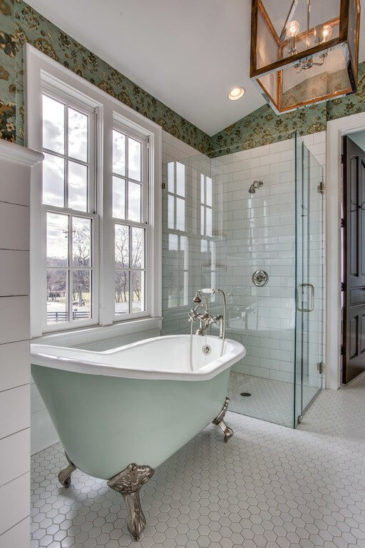 The clawfoot tub gives a nod to the past, while the sleek glass-enclosed shower is the most modern of amenities.
