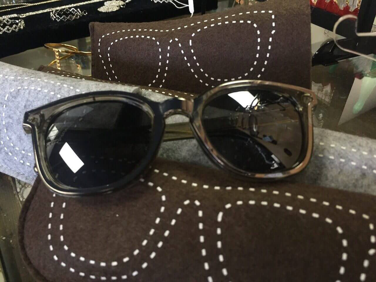 Mirrored sunglasses and flannel case, $22 at Pickering Boxwood