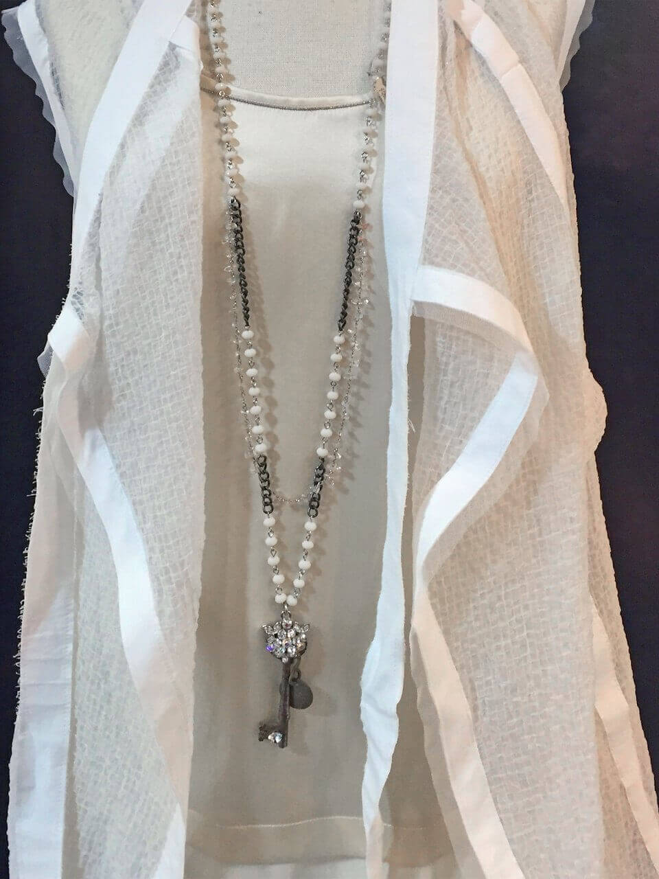 From Betsy Prince: vintage hotel key with rhinestones & rose quartz on glass bead chain, $275