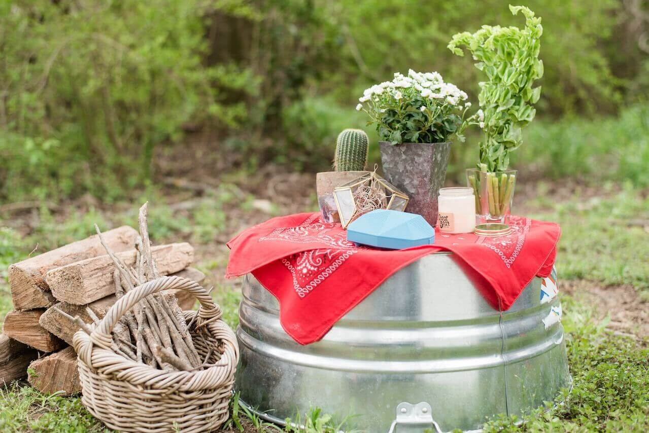 Bring flowers, greenery and candles to add a touch of ambience to your campsite. And make sure to gather kindling for your campfire before the sun goes down!