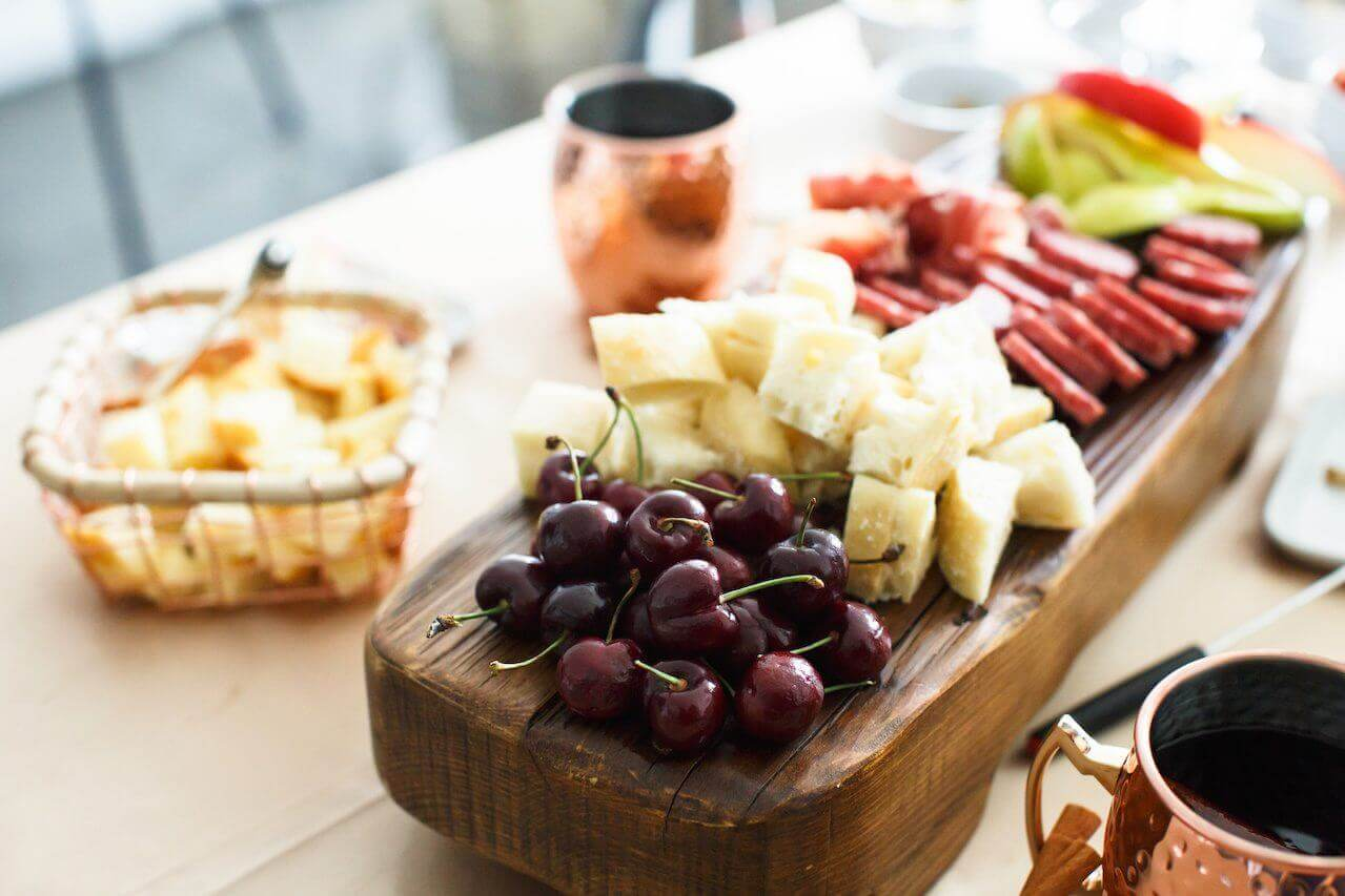 Select dipper options that could work with either cheese or chocolate, such as Bing cherries.