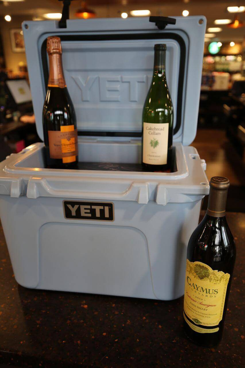 Yeti Roadie 20 cooler, $249.99; 2013 Cayman Cabernet Sauvignon, $84.99; 2013 Cakebread Chardonnay, $84.99 and a 2004 Veuve Clicquot Vintage Rose, $114.99, from Buster's Liquors and Wines.