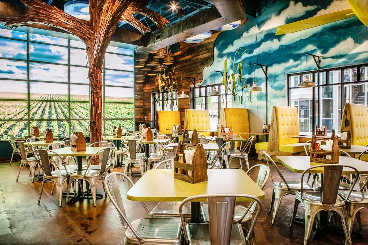 "Belly Acres, a fun, whimsical and restaurant in Overton Square ""with a never-ending supply of things to look at,"" says Glennys. ""That tree was made by our team using over 10,000 paint stir sticks!"""