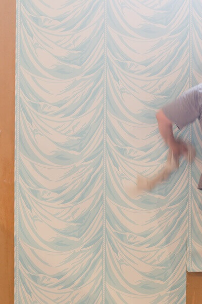 Dreamy, swag-like wallpaper is hung — we can't wait to see the finished room!