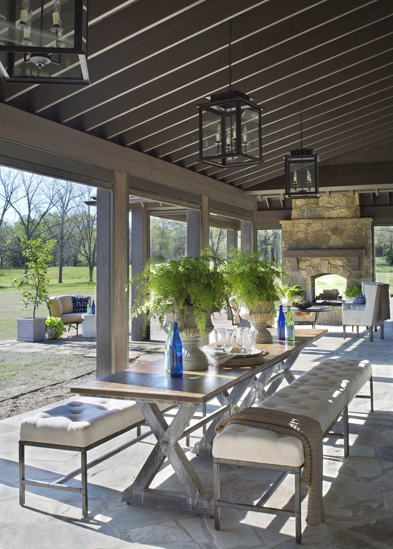 A long loggia features a two-sided fireplace at one end, as well as phantom screens that can lower to keep bugs at bay. The home rests on 22 acres in Eads, TN.