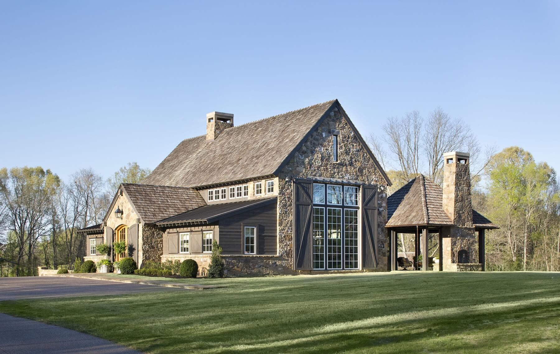 "Dubbed the ""Little Barn,"" this rustic stone house is sited to take maximum advantage of its rural, rolling, 22-acre site. Eventually the house will serve as a space for guests and events and will connect to a larger residence."