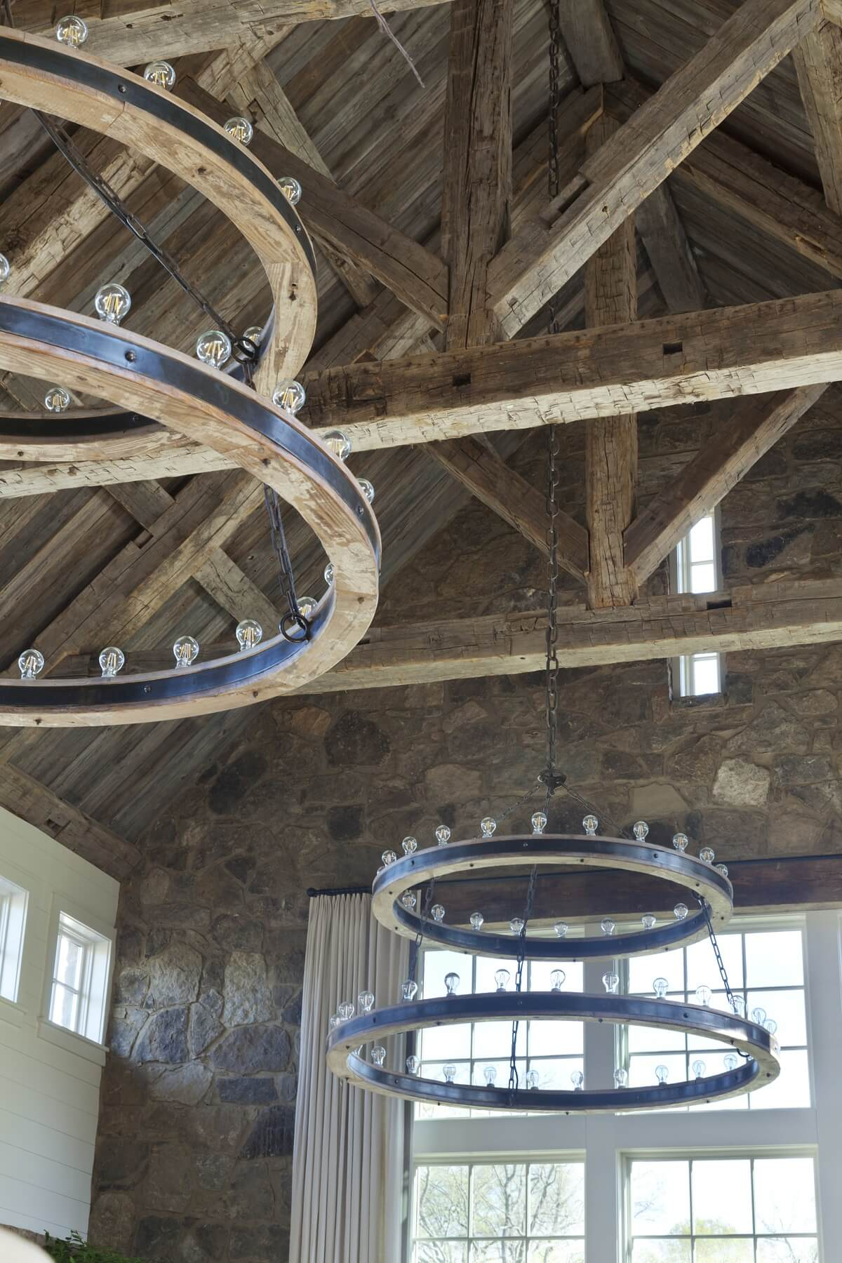 These massive light fixtures — 6-feet wide on the bottom rung and 5-feet wide on the top — are custom-fabricated to fit the scale of this cavernous space.