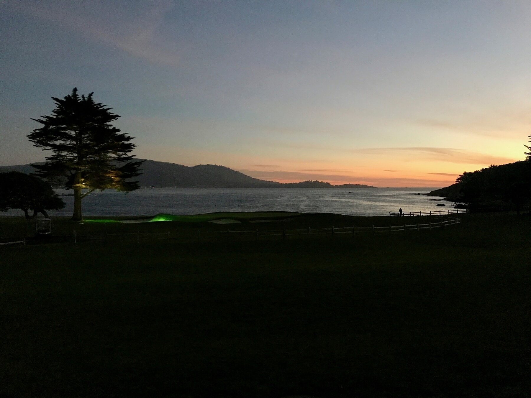 Watching the sunset over the 18th green at Pebble Beach is any golf enthusiast's paradise.