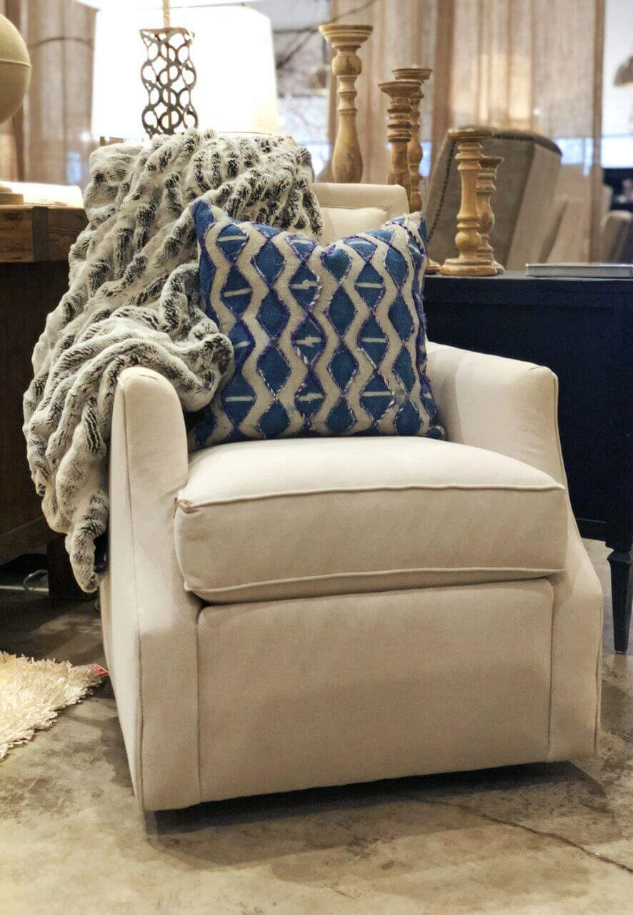 Chair, $730; pillow, $56; blanket, $291, at Stock & Trade Design Co.