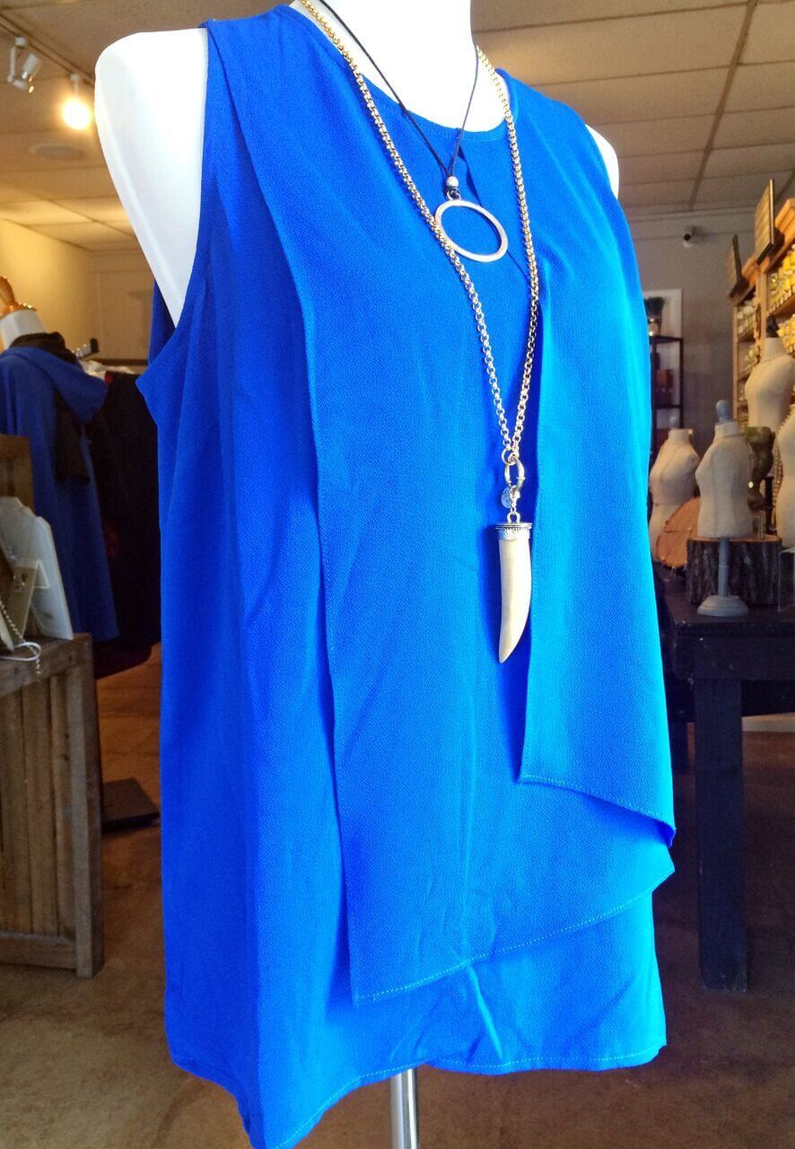 Ring necklace, $26; horn necklace, $38.95; blue tank $51.95, at The Blue Willow