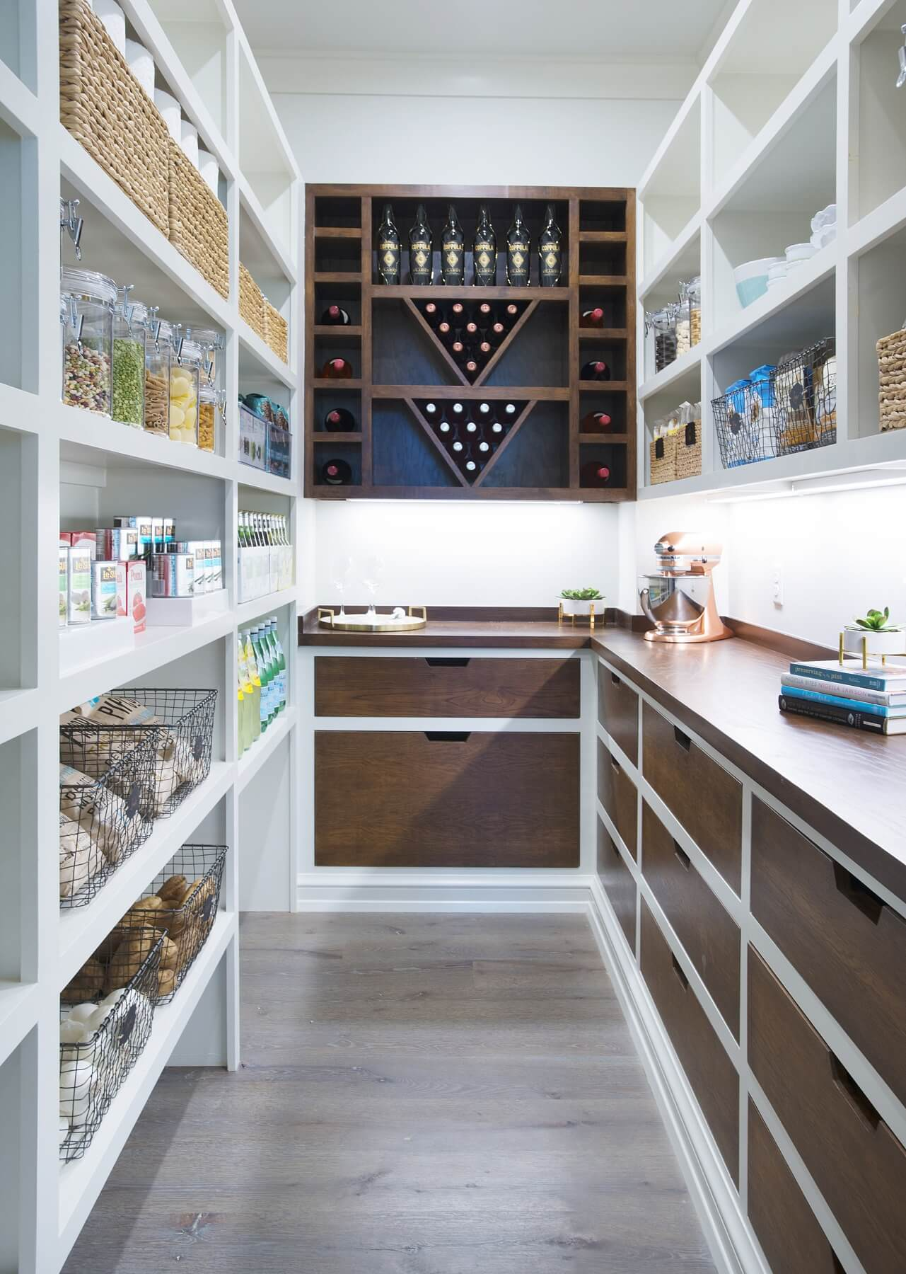 Pantries are much more than just food storage spaces. Stow away appliances, store your wine, house extra dishes and more.