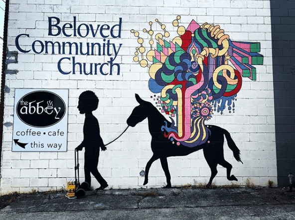 This colorful mural at The Abbey coffee shop is a beautiful backdrop to any photo.