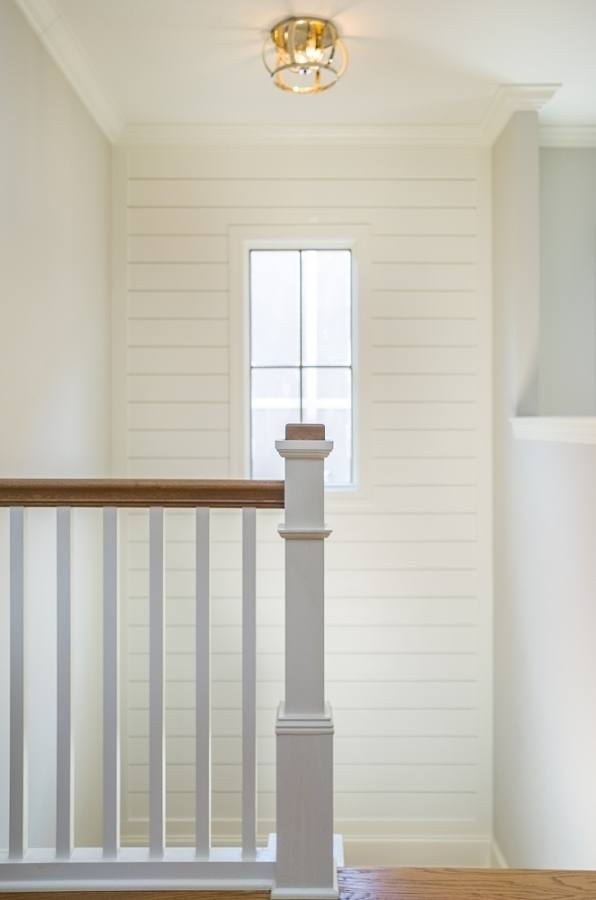 A simple stairway leads to the home's second floor.