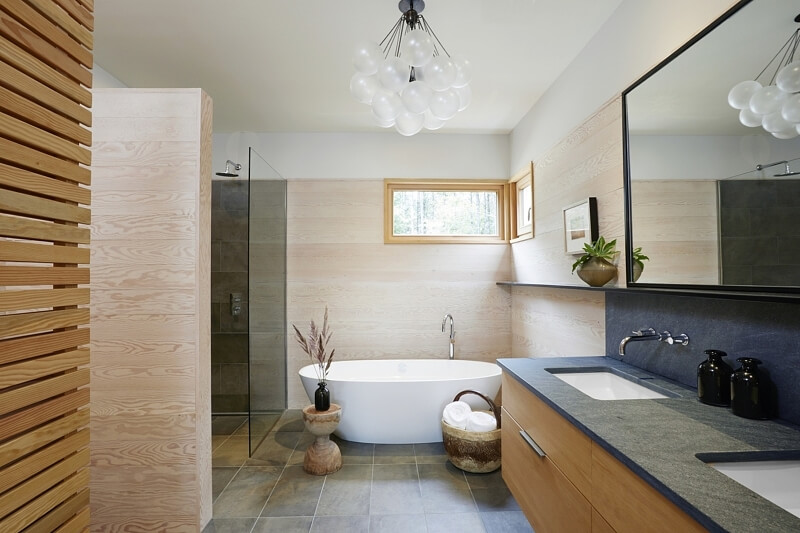 This bathroom has a decidedly spa-like feel — the perfect place to enjoy a soak.