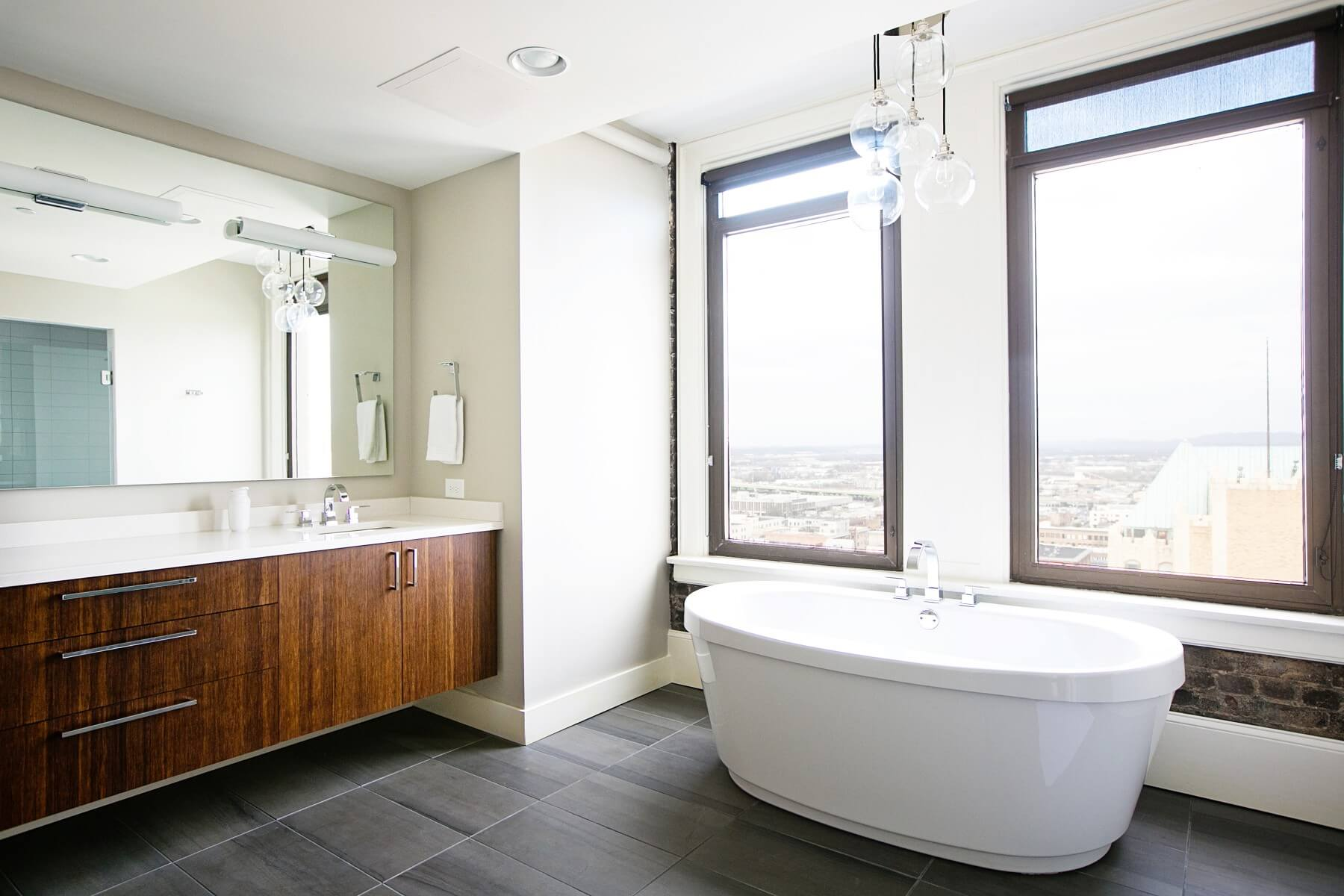 This gorgeous bathroom offers one of the best views of the Magic City from the 18th floor of the John Hand building. Image: Creature