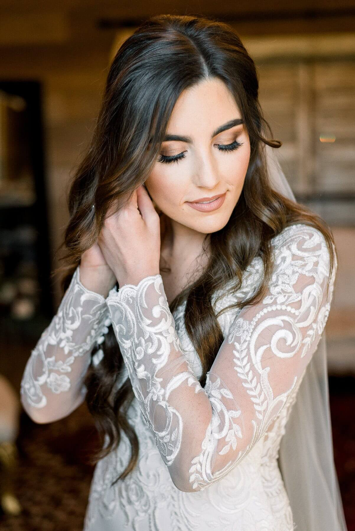 Ashley puts the finishing touches on her bridal look.
