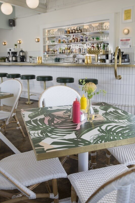 We love the custom palm pattern on the table tops. Image: Nathan Berry