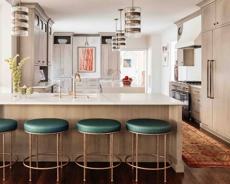 kitchen designed by Charlotte Lucas, with green barstools