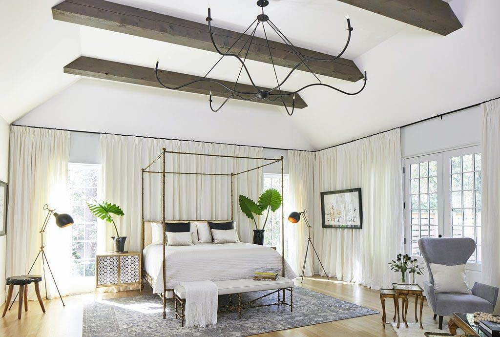 Master bedroom by Laura Vogtle. Wood beams on ceiling and four-poster bed