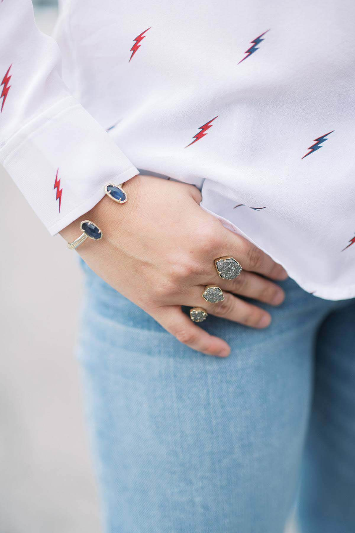Kendra Scott model with bracelet and ring