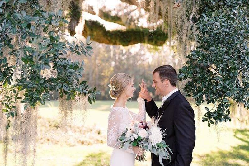 The bride and groom during first looks at their Charleston Plantation Wedding