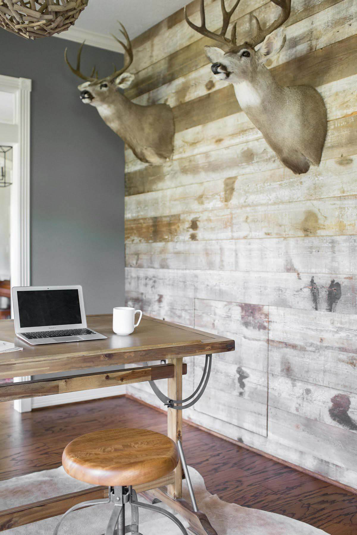Study with desk nook and hunting trophies in Houston farmhouse renovation