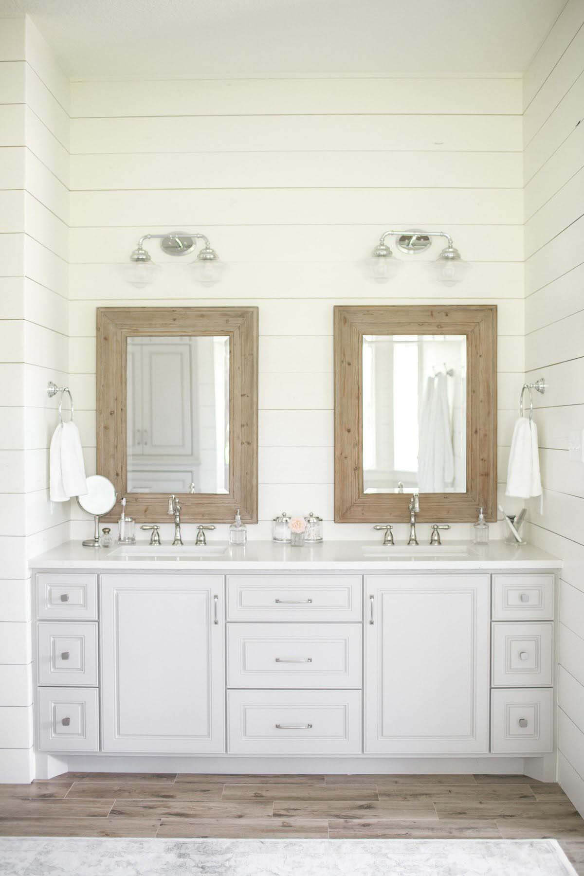 Bathroom vanity with mirrors and gray cabinetry