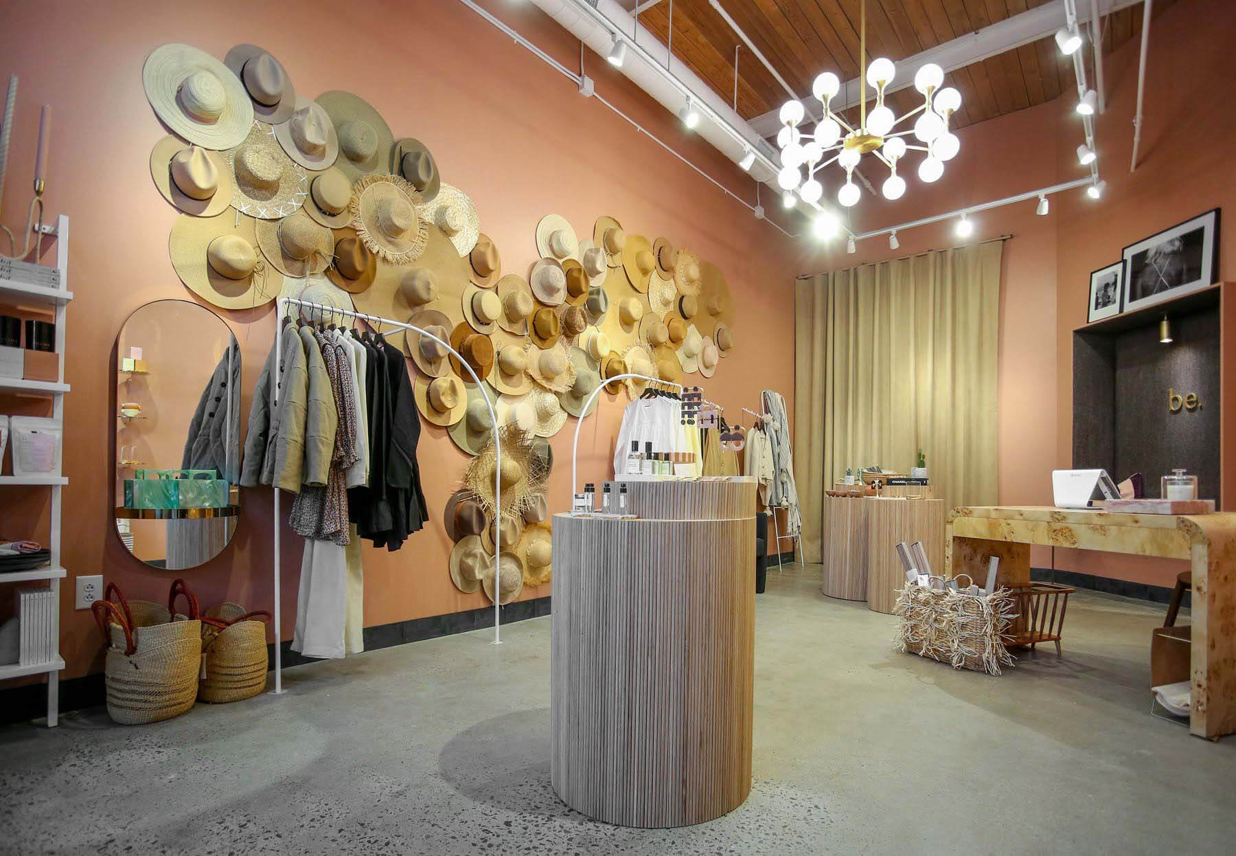 Interior hat wall at Happily Grey