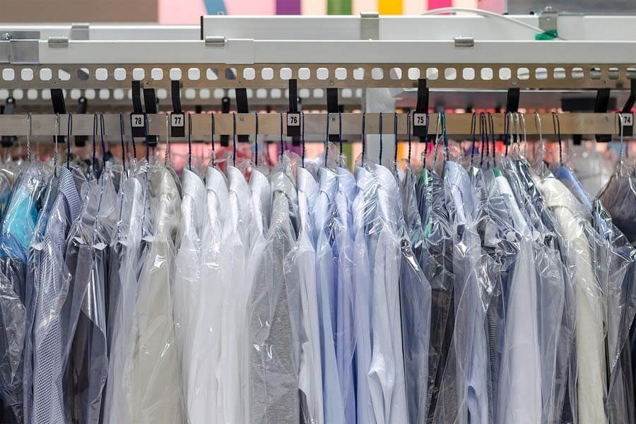 Shirts hanging up at dry cleaners