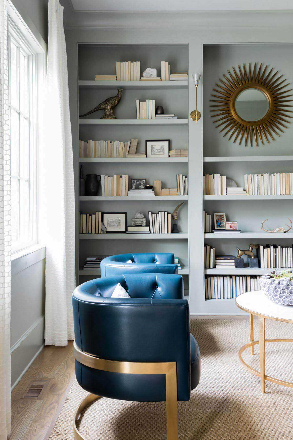 In-home library with shelves and blue chairs