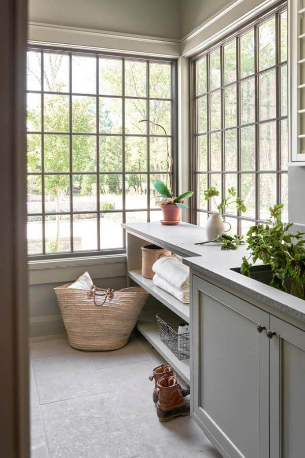 Laundry room with big windows designed by Pfeffer Torode