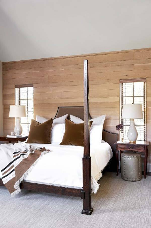 Master bed in front of wood focal wall at Forest Hills historic home