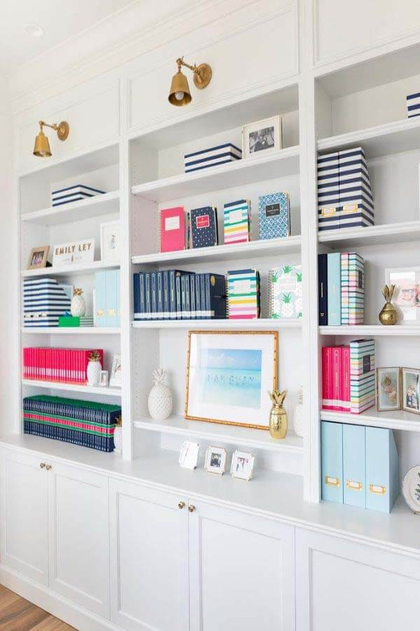 All white book shelves in Emily Ley's office