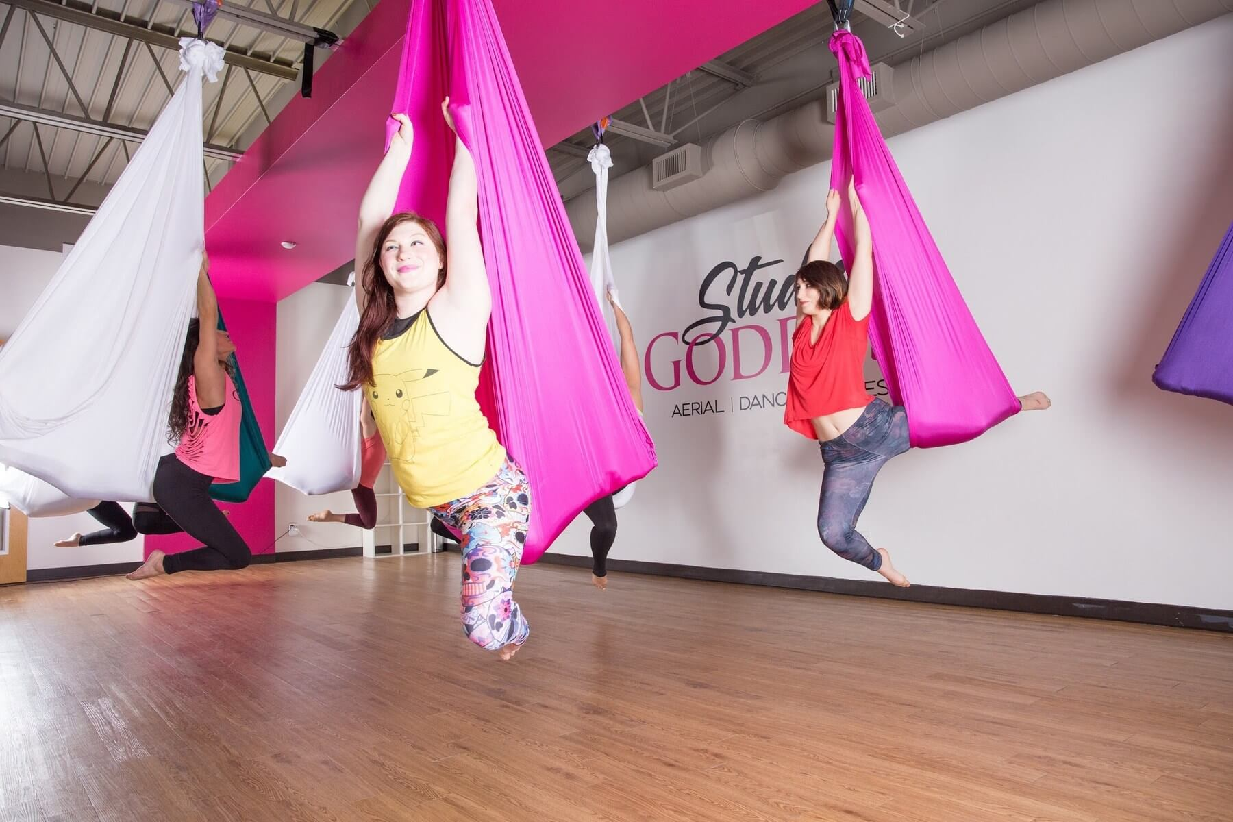 Women learning how to work aerial hammock at Studio Goddess