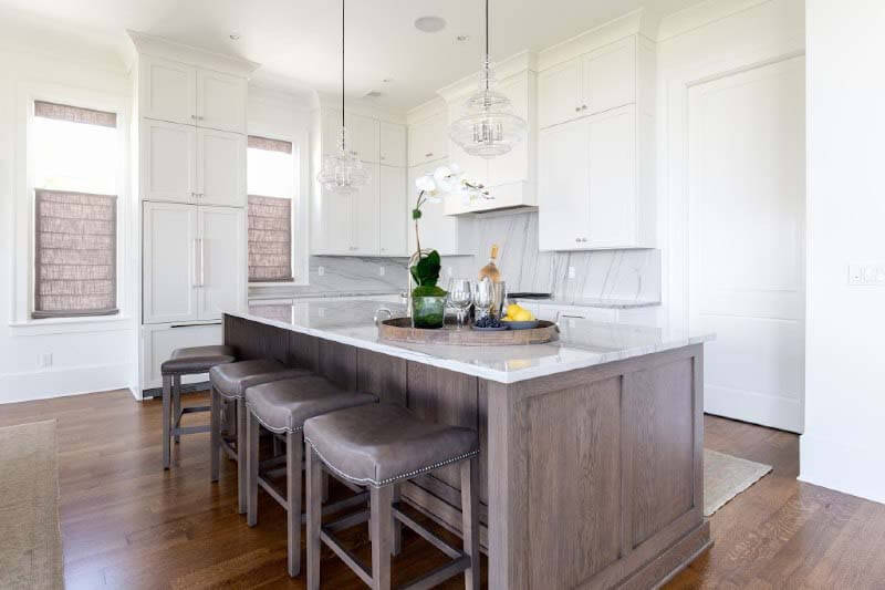 All-white kitchen in South Bluffs home
