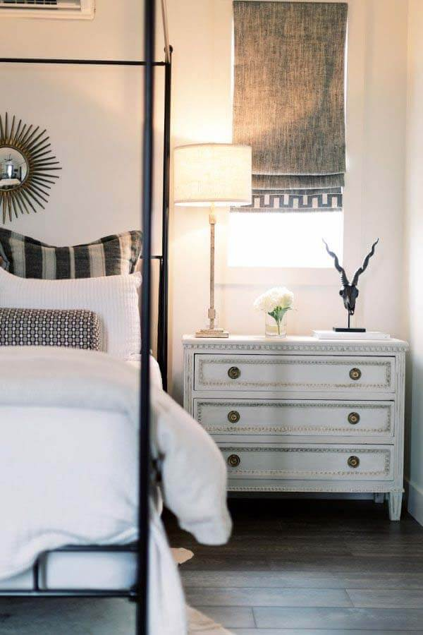 White bed next to nightstand