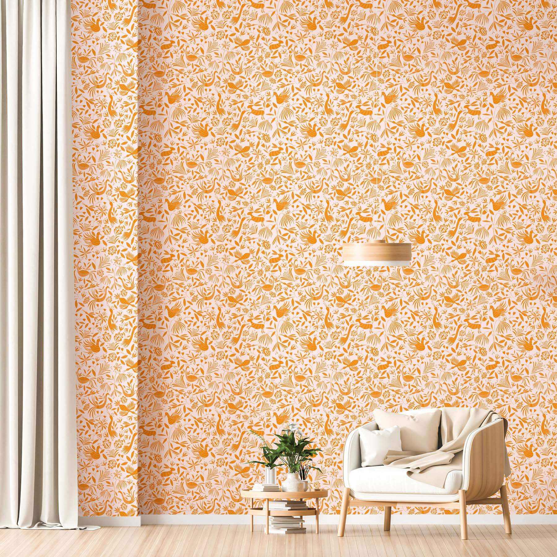 Scandinavian-style interior with wooden armchair in front of orange wallpaper installation