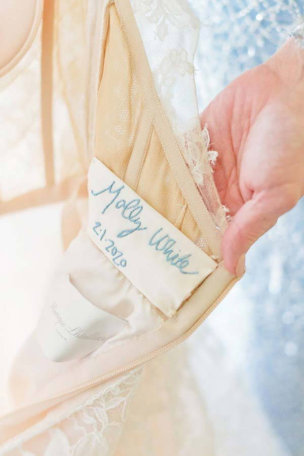 Blue stitching inside Molly's dress | Photographer: Kristyn Hogan